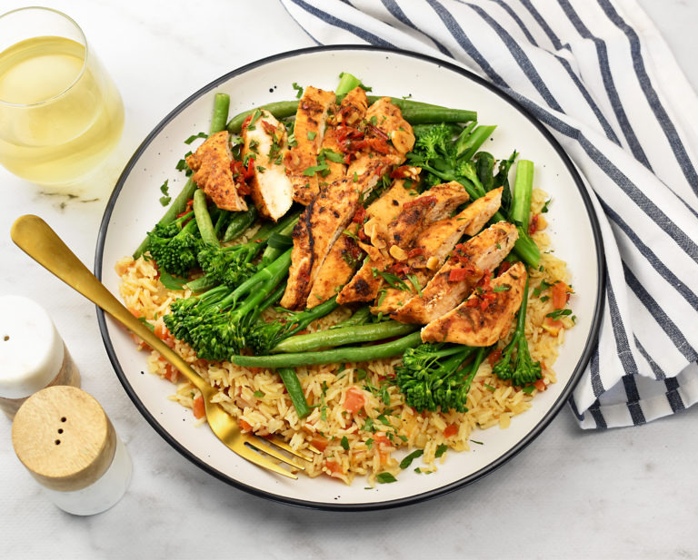 portugese chicken with tomato rice and broccolini